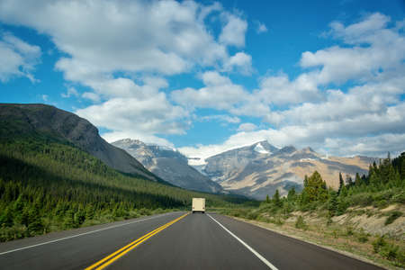 Driving on the Icefields Parkway between Banff and Jasper in the Canadian Rockies, Alberta, Canada  Stock Photo