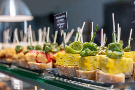 Traditional tapas and pinchos on a counter in a bar in Spain Stock Photo
