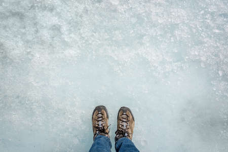 Feet on ice background, walking on Athabasca glacier in Columbia Icefield, Jasper National park,  Rocky Mountains, Alberta, Canada Stock Photo