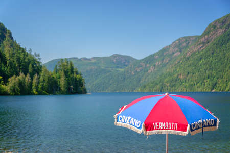 Advertising parasol branded Cinzano Vermouth near Cameron lake in Vancouver island, British Columbia, Canada