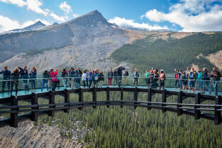 Tourists on Columbia icefields Skywalk, in Jasper National Park, Rocky Mountains, Alberta, Canada