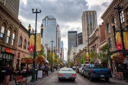 Busy people and cars on 8th avenue  in downtown Calgary, Alberta, Canada