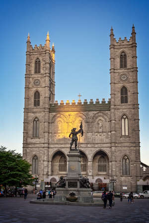 Place d'armes with Maisonneuve monument and Notre-Dame basilica in Old Montreal, Quebec, Canada Editorial