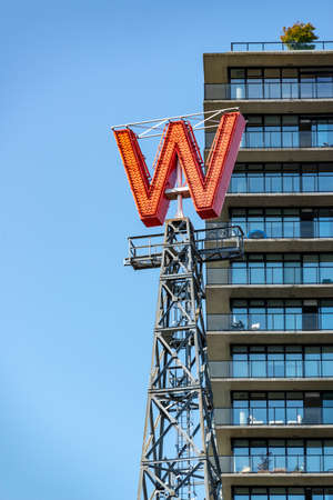 VANCOUVER, CANADA - AUGUST 3: Iconic W red neon sign of the Woodward's building, on August 3, 2019 in downtown Vancouver, Bristish Columbia, Canada Editorial