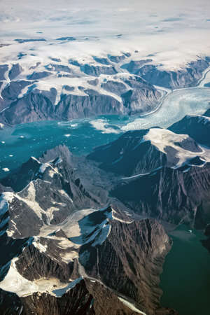 Western coast of Greenland, aerial view of glacier, mountains and ocean