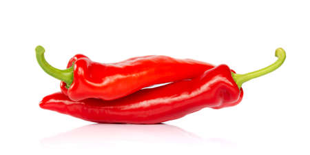 Two red hot chili pepper isolated on white background, looking like people having in 69 posture