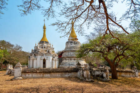 Buddhist white and golden temple in Old Bagan, Burma Myanmar