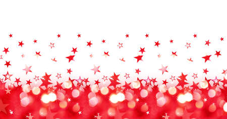 Shiny panoramic christmas holiday background of red lights with stars isolated on white Banco de Imagens