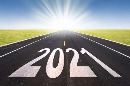 2021 road perspective with rising sun, new year card