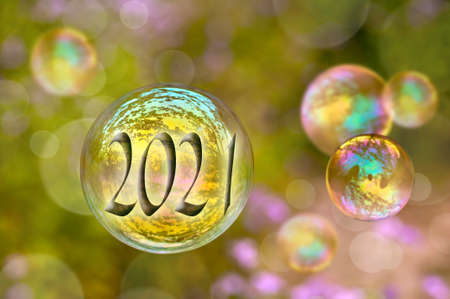2021 soap bubble on green nature background, new year greeting card