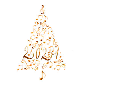2021 christmas tree with golden metal musical notes isolated on white background, music new year greeting card