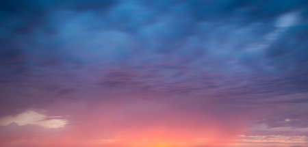 Pink and blue dramatic sky with clouds at sunset, panoramic nature background