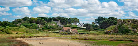 Scenic panoramic landscape with houses and rocks at Pors Hir, Côtes d'Armor, Brittany, France