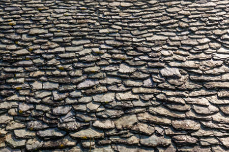 Close up of a flagstone roof in France