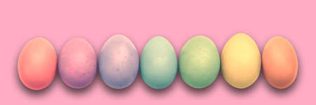 Pastel painted Easter eggs aligned in a row on pink panoramic background, Easter web banner Stock Photo
