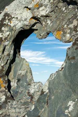 Rock with a hole in the shape of a heart