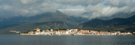 Town of Saint Florent, view from the sea, Corsica Stock Photo
