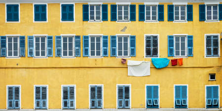 Yellow and blue facade with laundry in Bastia, Corsica