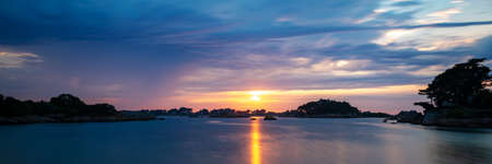 Panoramic sunset on the beach of Ploumanach in Perros-Guirec, Côtes d'Armor, Brittany, France