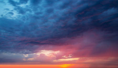 Colorful dramatic sky with clouds at sunset, nature background Stock Photo