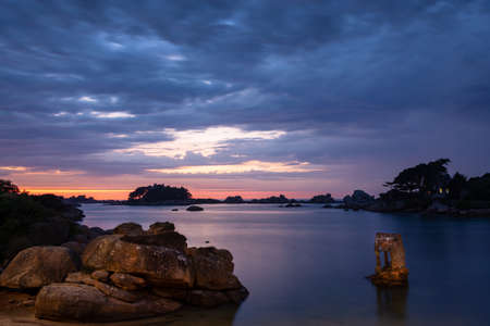 Sunset on the beach of Ploumanach at high tide in Perros-Guirec, Côtes d'Armor, Brittany, France