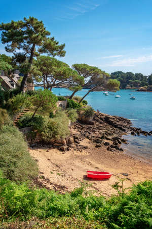Red boat in a small beach of Bréhat island in Côtes d'Armor, Brittany, France