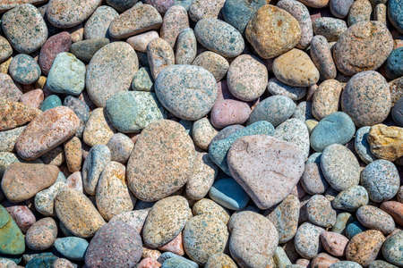 Colorful stones background on a beach