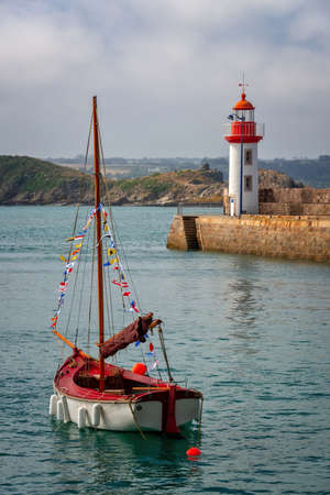 View of the picturesque harbor and lighthouse of Erquy, Côtes d'Armor, Brittany, France Stock Photo