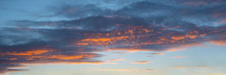 Colorful sky with clouds at sunset, panoramic nature background and web banner
