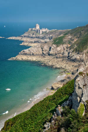 Fort La Latte, also called Castle of La Roche Goyon, view from the coastal footpath in in Côtes d'Armor, Brittany, France Editorial