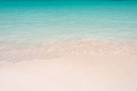Sand and caribbean tropical beach, summer background with copy space