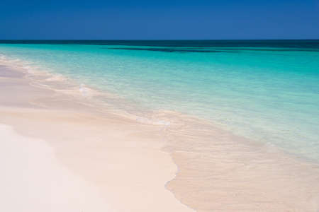 Perfect tropical beach and lagoon, summer background with copy space