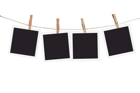 Four blank instant photo frames hanging on a rope, isolated on white background