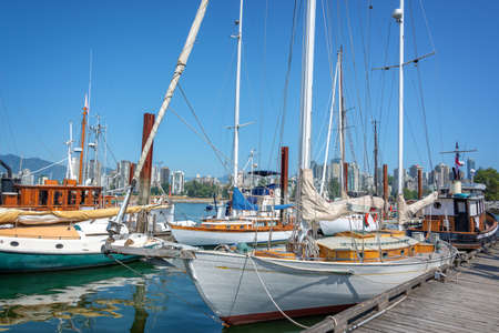 Old wooden boats in Vancouver heritage harbor, British Columbia, Canada