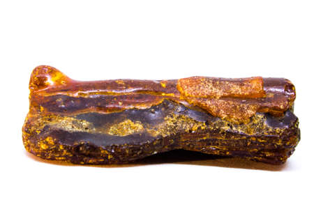 Natural untreated piece of amber on a white background