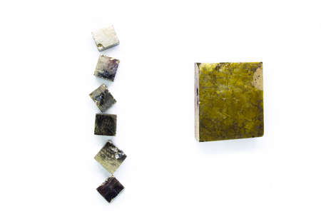 Pieces of different sizes natural pyrite cubic shape on white background