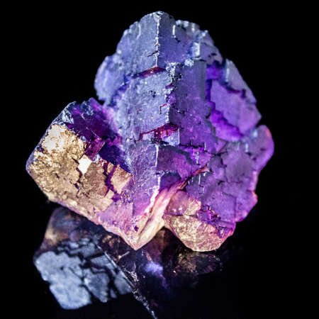 Natural raw fluorite of natural cut on a black background macro Stock Photo