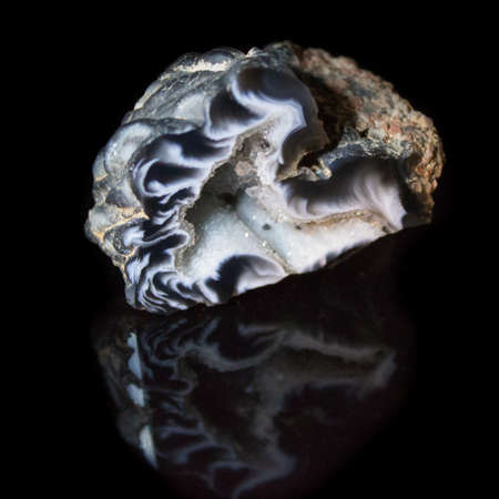 Natural geode polished agate on a black background macro Stock Photo