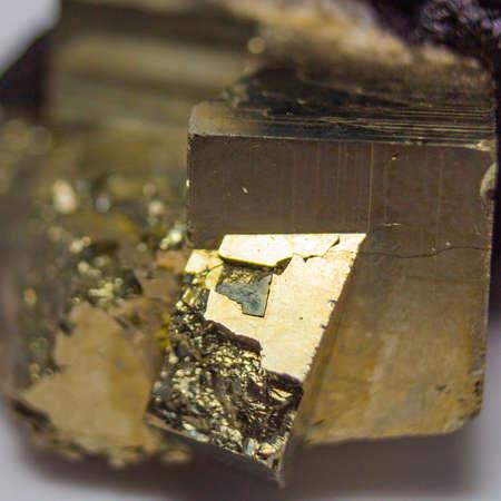 Natural pyrite natural cube cut with a metallic shine close up