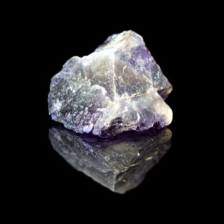 Natural rough stone fluorite on a black backround