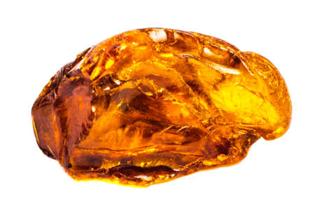 Natural piece of amber on a white background