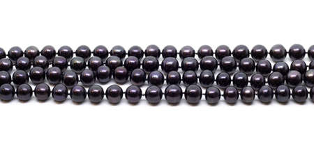 Natural cultered black pearl beads string on a white background Stok Fotoğraf