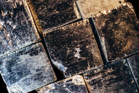 Background bricks of natural pyrite cubes close up