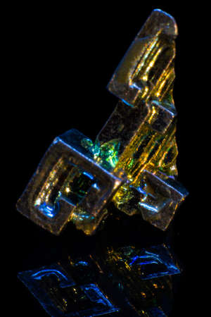 Synthetic iridescent stone bismuth macro on black background isolated