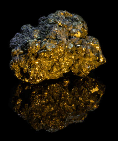 Natural druse of pyrite on a black background with reflection