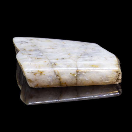 Natural piece of belomorite on black background with reflection