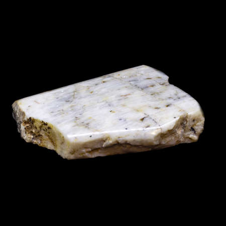 Natural piece of belomorite on black background isolated