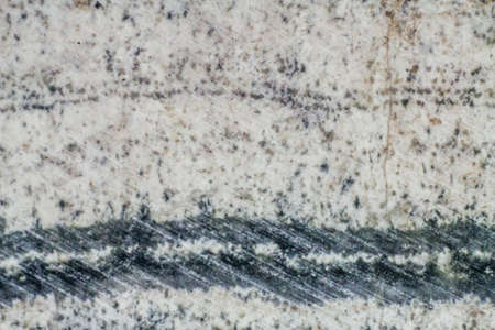 Close up texture of the saw cut the skarn with traces of polishing