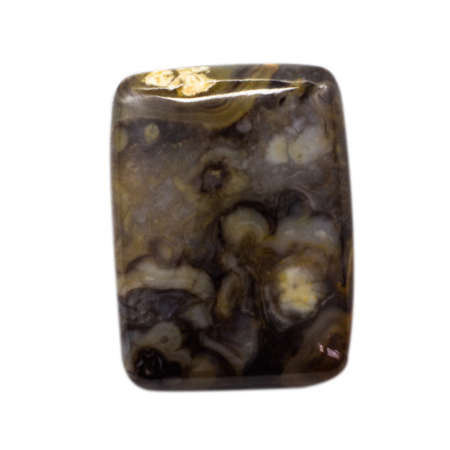 Natural cabochon of glossy cassiterite close up