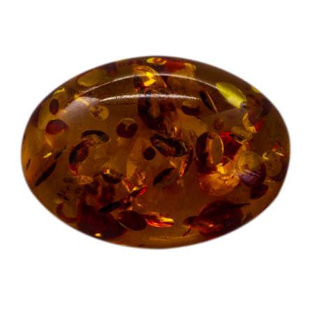Natural cabochon of glossy manmade amber close up